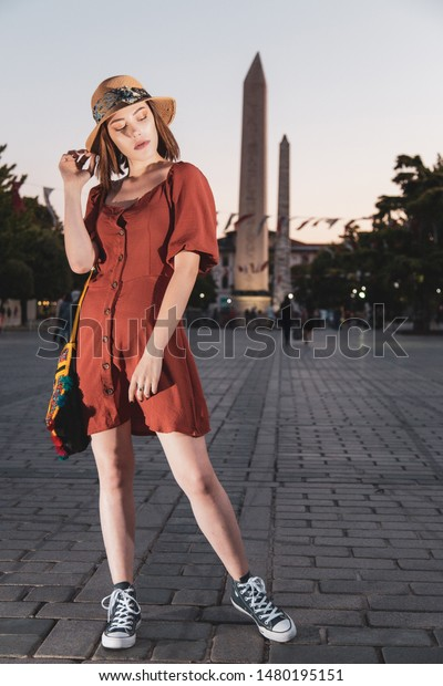 Beautiful girl with orange colored dress posing at old Hippodrome Square from Byzantine and Rome