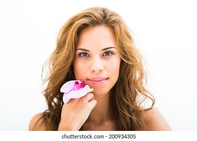 Beautiful Girl With Orchid Flowers.Beauty Model Woman Face.