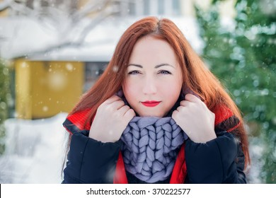 Beautiful girl outdoors against winter landscape