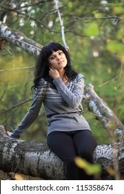Beautiful girl over autumn background.