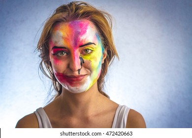 Beautiful girl and paint on the face, body art,  smile,  emotion, portrait