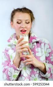 beautiful girl in pajamas with milk