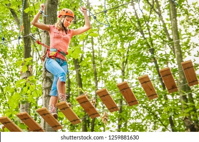beautiful girl in the park on the ropes achieve Outdoors