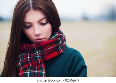 beautiful girl in the park so sad