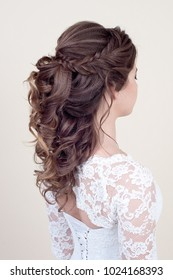Beautiful girl with perfect fashion makeup and hairstyle. Elegant female hairstyle for the wedding, unrecognizable rear view.
