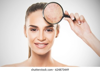 beautiful girl with perfect skin commercial face type holding magnifier beauty skin concept