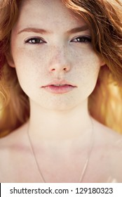 beautiful girl with perfect skin and red hair close-up