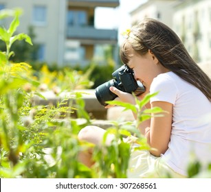 Beautiful girl photographing nature