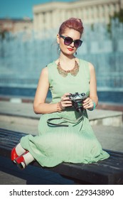 Beautiful girl with pink hair in vintage clothing
