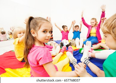 Beautiful girl playing circle games  with friends