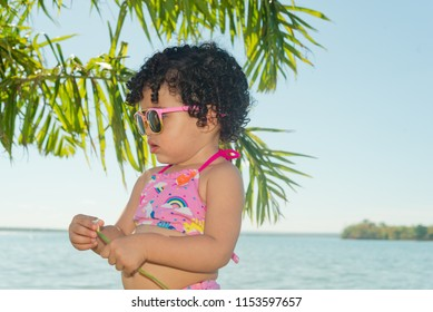Beautiful girl playing on the beach on a sunny day