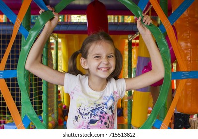Beautiful girl is playing on the playground.