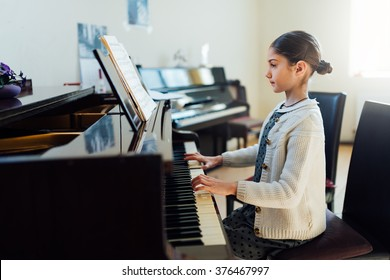 beautiful girl playing the piano at the School of Art
