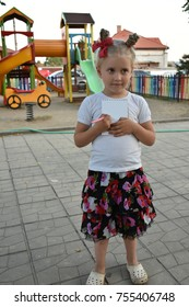 beautiful  of a girl plays on a playground