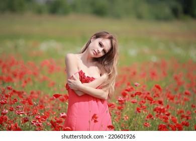 Beautiful Girl in the poppy field, red dress, outdoor