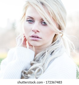 Beautiful girl portrait closeup. Cute girl outdoor portrait in park.