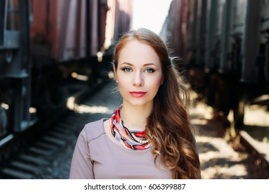 Beautiful girl portrait in outdoor. Beauty and fashion photo. Girl on the train station