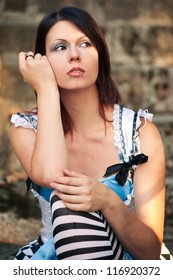 Beautiful girl portrait outdoors with retro dress.