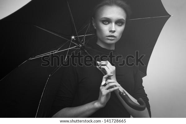 Beautiful girl portrait with umbrella outdoor