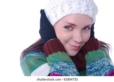 beautiful girl portrait in winter clothes on white