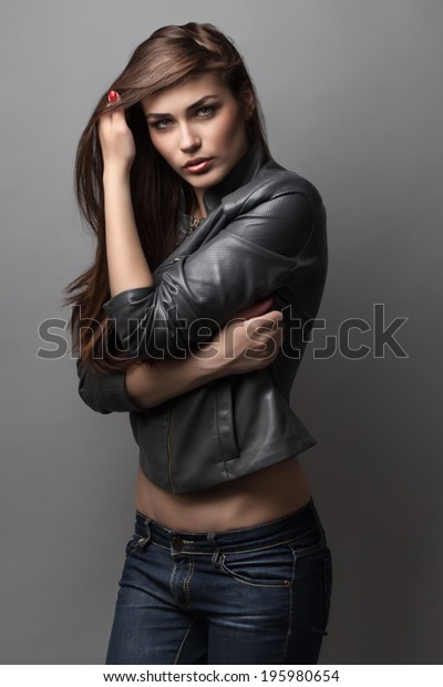Beautiful Girl Poses Studio On Gray Stock Photo (Edit Now) 195980654