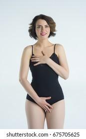 Beautiful girl posing in black body