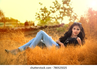 Beautiful girl posing in a field