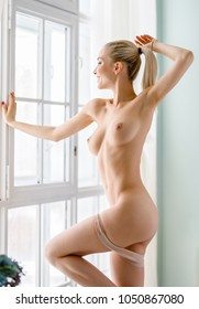 beautiful girl posing nude body at home