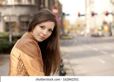 Beautiful girl posing on the street.