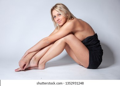 Beautiful girl posing for photo at home studio