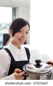 beautiful girl preparing dinner