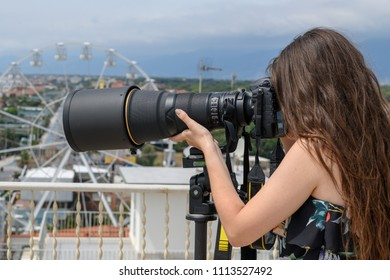beautiful girl professional photographer with super reflex