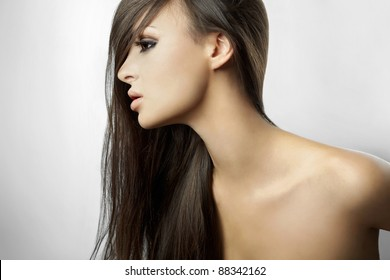 Beautiful girl in profile, with long hair isolated on white background