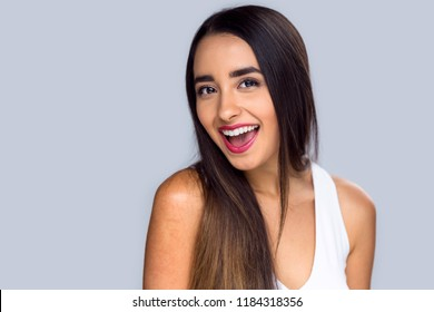 Beautiful girl proud and confident about her perfect white teeth smile