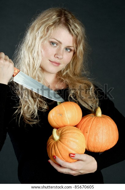 Beautiful girl with a pumpkin.
