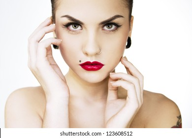 beautiful girl punk with tattu, piercing, red lipstick and perfect skin