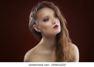 Beautiful girl with pure skin. day make-up on the dark background