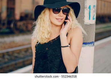 beautiful girl at raiway station. uses communication