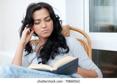 Beautiful girl reading the book