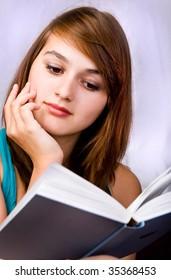 beautiful girl reads book