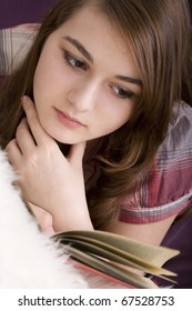 Beautiful girl reads book, closeup portrait