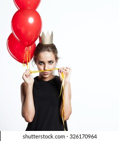 Beautiful girl with red balloons in golden crown  jokes