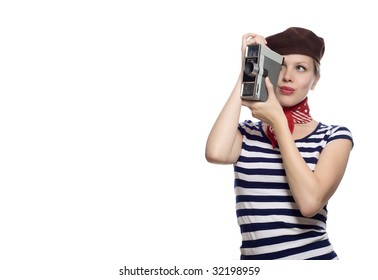 beautiful girl with red bandana, beret and striped shirt in a classic 60s french look holding a vintage 8mm substandard camera