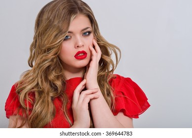 Beautiful girl in red dress on white background