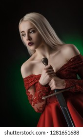 beautiful girl in red dress with sword