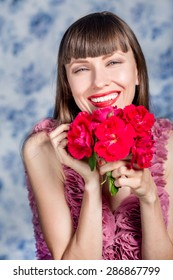 Beautiful girl with red flowers, focus on face