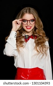 Beautiful girl in red glasses. Student.