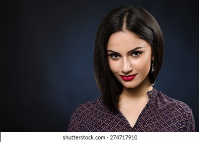 Beautiful girl with red lips smile in the studio