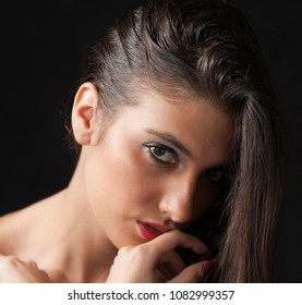 Beautiful girl with red lipstick looking sad and innocent