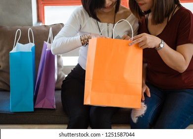 Beautiful girl relax shopping and Happy young woman relax looking shopping bags.